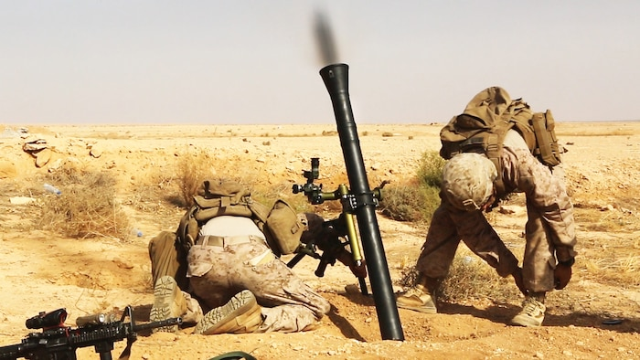 U.S. Marines with Weapons Company, 1st Battalion, 7th Marine Regiment, Special Purpose Marine Air-Ground Task Force--Crisis Response--Central Command, fire a M252A2 81 mm mortar system during a live-fire training mission at Al Asad Air Base, Iraq, Oct. 24, 2015. The training allowed the Marines to maintain proficiency while also expanding their knowledge on the new weapons system.  These Marines are supporting Combined Joint Task Force – Operation Inherent Resolve, which has 65 coalition partners who are committed to the goals of eliminating the threat posed by the Islamic State of Iraq and the Levant.