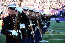 Marines with the Silent Drill Platoon performed during the MN Vikings game in Minneapolis, MN, November 8, 2015. In addition to performing a spectacular half-time show, the Marines also honored Tyler Johnson, a high school student from Minneapolis, selected to play in the Semper Fi All American Bowl.
