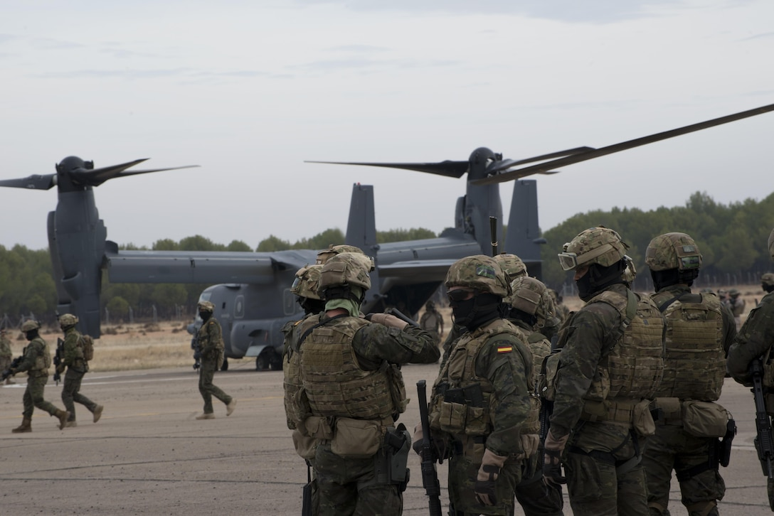 Air commandos prepare to board a CV-22 Osprey from the 352d Special Operations Wing in Almagro, Spain, Oct 24, 2015. The event was held as a part of TRIDENT JUNCTURE where partner nations trained air and ground forces on personnel rapid on and off-loading techniques. U.S. Air Force photo by 1st Lt. Chris Sullivan/Released)