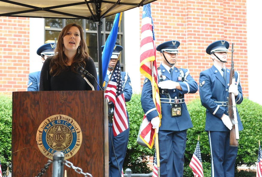 Emily Waites, wife of Maj. Michael Waites, 50th Flying Training Squadron Assistant Operations Officer, sings the National Anthem while the Columbus Air Force Base Honor Guard presents the colors during the Columbus, Mississippi, Veterans Day Ceremony Nov. 7 at the Lowndes County Courthouse. After the National Anthem, Pastor Jerry Mitchell of Mt. Vernon Church gave the invocation for the ceremony. (U.S. Air Force photo/Senior Airman Kaleb Snay)