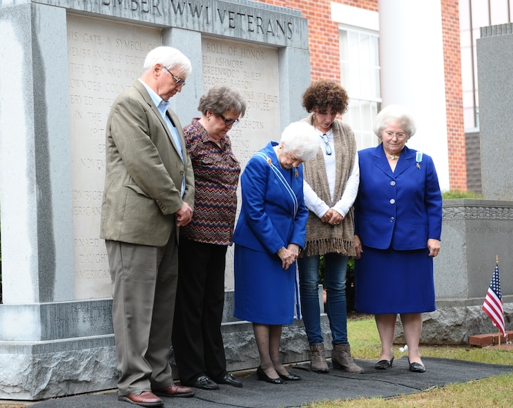 Members of the Lowndes County Board of Supervisors and the Daughters of the American Revolution bow their heads in a moment of prayer after rededicating a memorial monument during the Columbus, Mississippi, Veterans Day Ceremony Nov. 7 at the Lowndes County Courthouse. Alice Stallworth Lancaster, Regent of the Bernard Romans Chapter Daughters of the American Revolution, read 22 names of those who did not return and who are listed on the right plaque of the monument. (U.S. Air Force photo/Senior Airman Kaleb Snay)