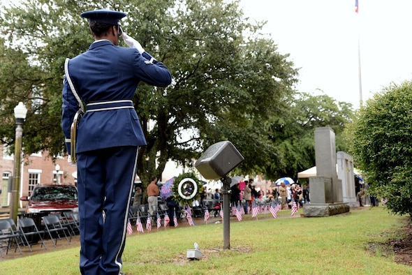 Airman 1st Class Brianna Brown, 14th Flying Training Wing Honor guardsman, salutes the flag during the presentation of Colors at the 2015 Veterans Day Ceremony Nov. 7 in Columbus, Mississippi. During the ceremony, Alice Stallworth Lancaster, Regent of the Bernard Romans Chapter Daughters of the American Revolution, read 22 names of those who did not return and who are listed on the right plaque of the monument. Afterward Col. John Nichols, 14th Flying Training Wing Commander, spoke on what Veterans Day meant to him before he laid a wreath on the memorial and offered a salute to close the day's event with Harry Sanders, Lowndes County Board of Supervisors President, and Vice Columbus Mayor Gene Taylor. For story and more photos, see pages 8 and 9. (U.S. Air Force photo/Airman 1st Class John Day)