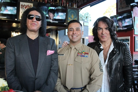 Gunnery Sgt. Roberto Castillo, Recruiting Station Los Angeles Military Entrance Processing Station liasion, poses for a photo with Rock and Roll Hall of Famers Gene Simmons and Paul Stanley of KISS, Nov. 11, 2015, for a Veterans Day tribute at the Rock and Brews in El Segundo, Calif. The event was televised on KTLA Morning News. (U.S. Marine Corps photo by Sgt. Alicia R. Leaders/Released)