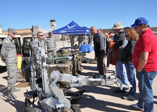 944th Civil Engineer Squadron explosive ordnance disposal members, provide an exhibit for 944th Fighter Wing Airmen civilian employers during the Boss's Day event Nov. 7 at Luke Air Force Base, Ariz. (U.S. Air Force photo taken by Tech. Sgt. Barbara Plante)