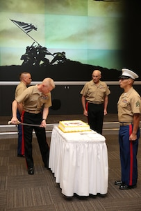 Brigadier General Paul J. Rock Jr., the Director for the U.S. Southern Command's Strategy, Policy, and Plans division, cuts a piece of cake during the SOUTHCOM and U.S. Marine Corps Forces, South, birthday celebration Nov. 10, 2015.   Service members from SOUTHCOM and MARFORSOUTH came together during a cake cutting ceremony to commemorate the 240th anniversary of the U.S. Marine Corps.  (U.S. Marine Corps Photos by SSgt Earnest. J. Barnes/Released)