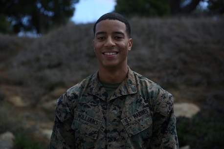 Corporal Brian Williams, the designated driver for the commanding general, 1st Marine Division, and wide receiver for the Headquarters Battalion Wolverines. While Williams is dedicated to his team, his duties as a Marine will always come first aboard Marine Corps Base Camp Pendleton, Calif. The Atlanta native ties his life of wearing shoulder pads to his desire to wear his Eagle, Globe and Anchor. (Official Marine Corps Photo by Cpl. Will Perkins)