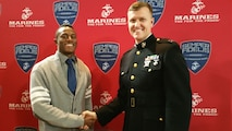 Capt. Joshua DeWalt, operations officer, Recruiting Station Sacramento, congratulates Darian West, wide receiver, Clovis West High School, for his selection for the Semper Fidelis All-American Bowl. Owens will play among the nation's elite football players during the game in January.