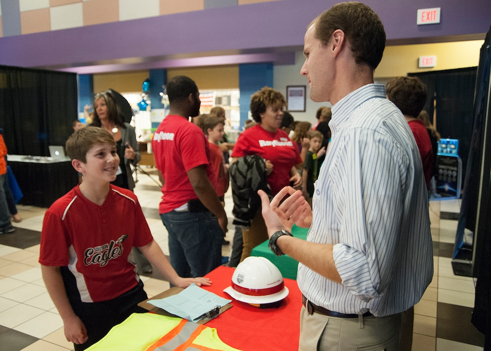 John Nevels, a structural engineer with the Engineering and Support Center, Huntsville explains his role in the Explosives Safety Program to Mill Creek Elementary School sixth-grader Joey Crider during a STEAM event Nov. 10.