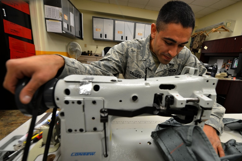 Airman 1st Class Jerry Salcido, a 20th Operations Support Squadron aircrew flight equipment specialist, sews a PCU-15B/P torso harness at Shaw Air Force Base, S.C., Oct. 21, 2015. AFE airmen inspect, maintain and service all aircrew's gear to ensure it is in working order and has no discrepancies. (U.S. Air Force photo/Senior Airman Michael Cossaboom)