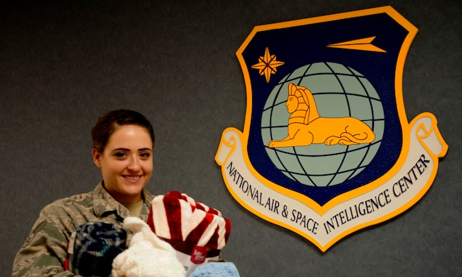 Senior Airman Rochelle Hansen, National Air and Space Intelligence Center accounts management technician, is on a mission to help three area Combined Federal Campaign organizations. She is collecting blankets for the St. Vincent De Paul Shelter, the Artemis Foundation and the Young Women's Christian Association of Dayton. Hansen is assigned to NASIC located on Wright-Patterson Air Force Base, Ohio. (U.S. Air Force photo by Master Sgt. Tammie Moore)