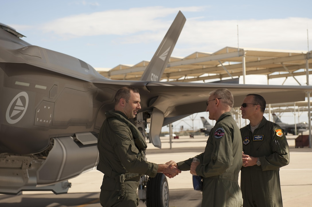 Maj. Gen. Morten Klever, program director of the Norwegian F-35 Program, accepts the first two Norwegian F-35s after they arrived at Luke Air Force Base, Arizona, Nov. 10, 2015. Shortly after, a Norwegian pilot flew the F-35 Lightning II for the first time, in conjunction with the Royal Norwegian air force's birthday. (U.S. Air Force photo by Staff Sgt. Staci Miller)