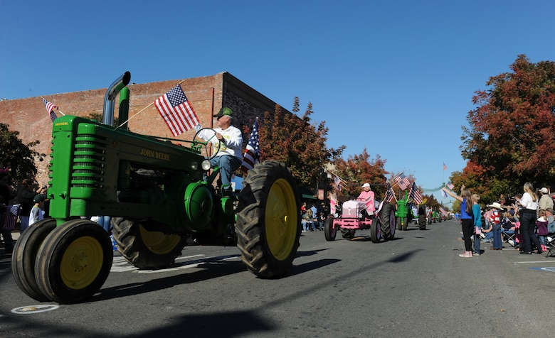 Local farmers ride vintage tractors during the Yuba/Sutter Veterans Day Parade in Marysville, California, Nov. 11, 2015. The local counties have a rich history in agriculture. (U.S. Air Force photo by Staff Sgt. Robert M. Trujillo/Released)