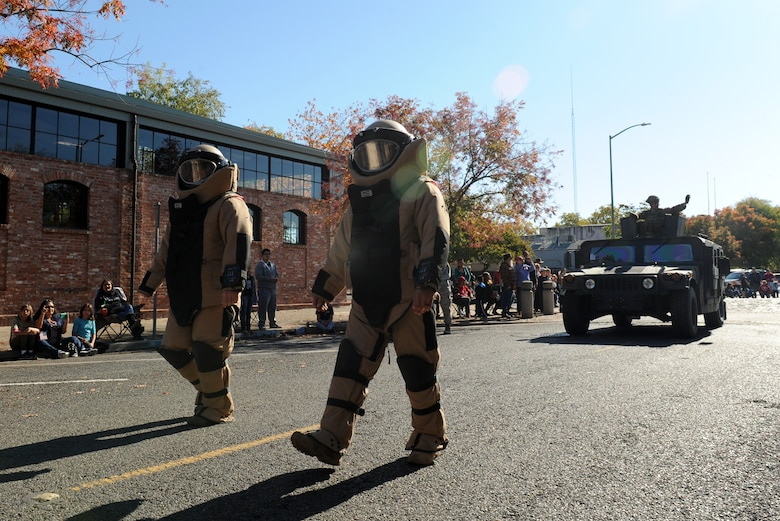 Members of the 9th Civil Engineer Squadron, Explosive Ordnance Disposal team, display protective suits during the Yuba/Sutter Veterans Day Parade in Marysville, California, Nov. 11, 2015. Veterans Day is celebrated throughout the U.S. to honor those who have served and are serving in the Armed Forces. (U.S. Air Force photo by Staff Sgt. Robert M. Trujillo)