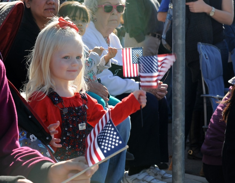 Spectators watch the Yuba/Sutter Veterans Day Parade in Marysville, California, Nov. 11, 2015. Veterans Day is celebrated throughout the U.S. to honor those who have served and are serving in the Armed Forces. (U.S. Air Force photo by Staff Sgt. Robert M. Trujillo)