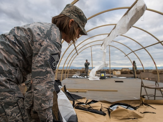 Master Sgt. Ann Mitchell, 366th Force Support Squadron sustainment flight superintendent, deconstructs an Alaskan SSS multi-purpose tent during Gunfighter Flag 16-1, Nov. 6, 2015, at Mountain Home Air Force Base, Idaho. The tents provide shelter for lodging, food preparation and briefings areas. (U.S. Air Force photo by Airman 1st Class Connor J. Marth)