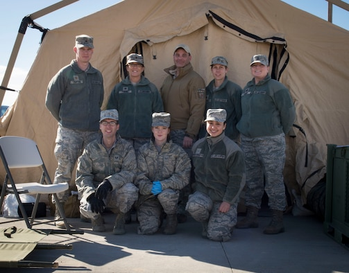 A surgical team poses for a group photo at Mountain Home Air Force Base, Idaho, Nov. 5, 2015. The surgical team included guardsmen from Fairchild AFB, Washington. They participated in Gunfighter Flag 16-1 exercise to train realistically for deployment missions. (U.S. Air Force photo by Airman 1st Class Jessica H. Evans/RELEASED)