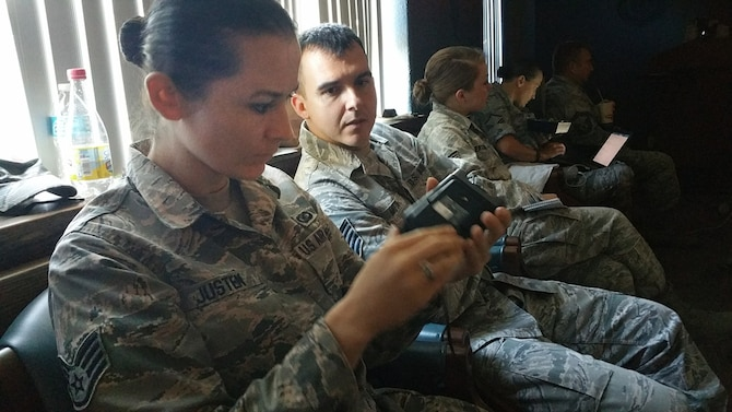 Staff Sgt. Katie Justen, 459th Air Refueling Wing public affairs, Joint Base Andrews, Maryland, and Tech Sgt. Benjamin Mota, 434th Air Refueling Wing public affairs, Grissom Air Reserve Base, Indiana, take a look at new Canon technology at the Fourth Air Force Public Affairs Conference held at March Air Reserve Base, California, on Nov. 3-5, 2015. Public Affairs officers, enlisted and civilians from across the numbered Air Force, as well as their Air National Guard counterparts, attended the conference to network, share best practices, and discuss ways to overcome obstacles in the PA career field. (U.S. Air National Guard photo/Master Sgt. Julie Avey)