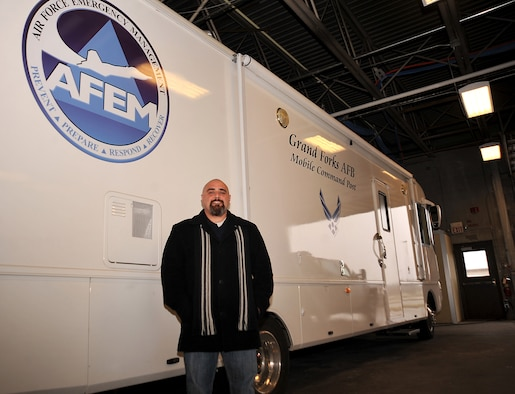 Shawn Leach, 319th Civil Engineer Squadron emergency management specialist, is in charge of ensuring the emergency management program runs smoothly and that all base members are prepared for any hazards on Grand Forks Air Force Base, North Dakota, Nov. 12, 2015. Leach was named Warrior of the Week for the second week in November. (U.S. Air Force photo/Airman 1st Class Bonnie Grantham/Released)