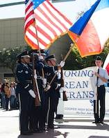 U.S. Air Force Airmen in the Dyess Air Force Base Honor Guard present the colors and Texas state flag at the annual Veteran's Day Parade on Nov. 7, 2015 in downtown Abilene, Texas. This year, the parade was dedicated to honoring veterans of the Korean War. (U.S. Air Force Photo by Airman 1st Class Katherine Miller/Released)