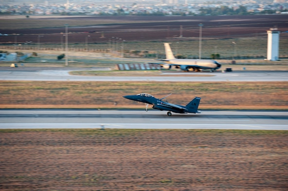 A U.S. Air Force F-15E Strike Eagle lands on the runway Nov. 12, 2015, at Incirlik Air Base, Turkey.  Six F-15Es from the 48th Fighter Wing deployed to Incirlik deployed as a part of Operation Inherent Resolve in coordination with the Turkish Government and to reinforce our shared commitment to the fight against ISIL in Iraq and Syria. These aircraft are designed to perform air-to-air and air-to-ground missions in all weather conditions. (U.S. Air Force photo by Staff Sgt. Jack Sanders/Released)