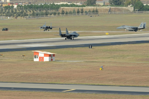 Three F-15C Eagles from the 493rd Fighter Squadron at RAF Lakenheath, UK, taxi the flightline at Incirlik Air Base, Turkey, Nov. 6, 2015. The six F-15Cs are deployed to Incirlik to conduct combat air patrols in Turkish air space. (U.S. Air Force photo by Tech. Sgt. Taylor Worley/Released)