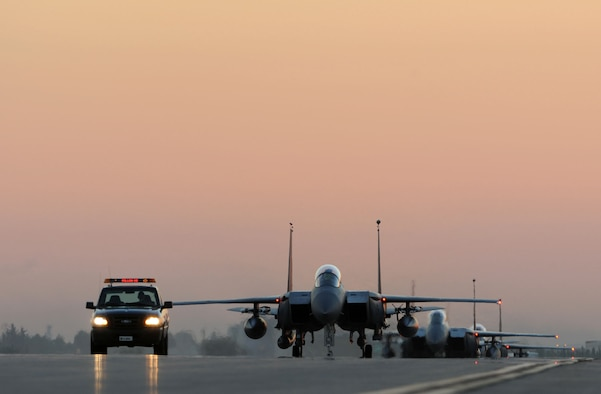 U.S. Air Force F-15E Strike Eagles taxi the runway after landing Nov. 12, 2015, at Incirlik Air Base, Turkey. The Strike Eagles deployed to Incirlik AB to conduct counter-ISIL missions in Iraq and Syria in support of Operation Inherent Resolve. This dual-role fighter designed to perform air-to-air and air-to-ground missions in all weather conditions. (U.S. Air Force photo by Tech. Sgt. Taylor Worley)