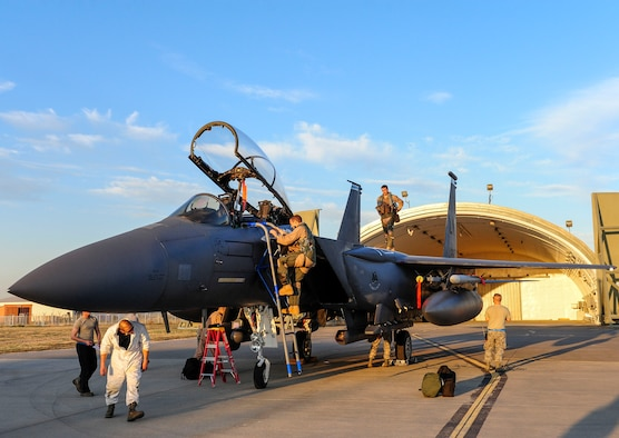 A U.S. Air Force pilot steps out of an F-15E Strike Eagle aircraft shortly after arriving at Incirlik Air Base, Turkey Nov. 12, 2015. Six F-15E Strike Eagles deployed to Incirlik AB from the 48th Fighter Wing, based at RAF Lakenheath, UK, in support of Operation Inherent Resolve and counter-ISIL missions in Iraq and Syria. This dual-role fighter jet is designed to perform air-to-air and air-to-ground missions in all weather conditions. (U.S. Air Force photo by Airman 1st Class Cory W. Bush/Released)