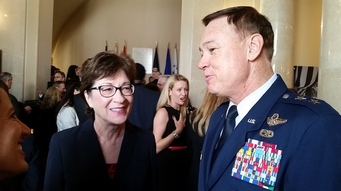 Air Force District of Washington Commander Maj. Gen. Darryl Burke speaks with 