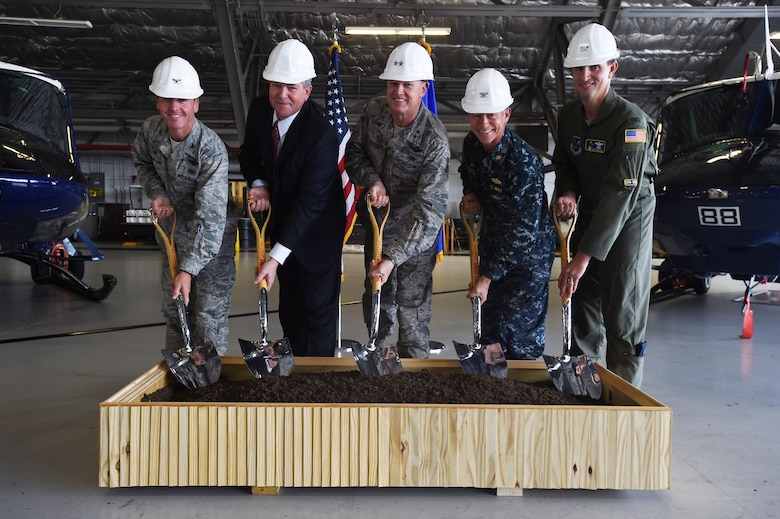 Team Andrews leadership pose during a ground breaking ceremony for the 811 Operations Group at Joint Base Andrews, Md., Nov. 12, 2015. The new facility will provide space for mission planning, briefing, training, flight simulation, operations and administration. (U.S. Air Force photo by Senior Airman Joshua R. M. Dewberry/Released)