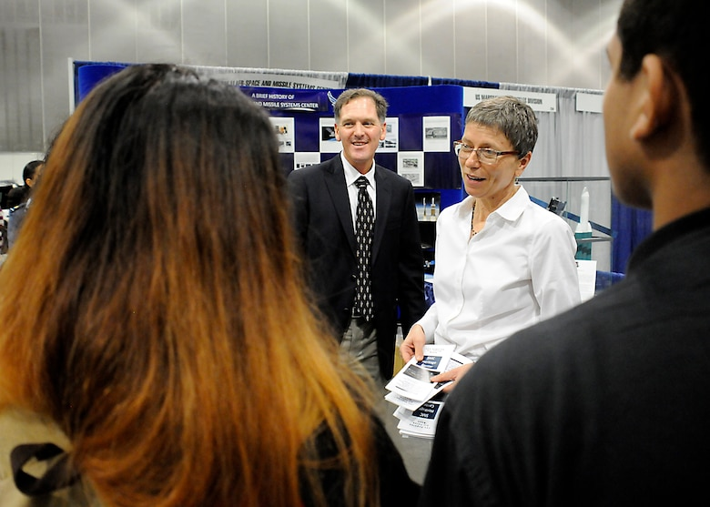Michael Lane Gilchrist, a contractor with Alpha Omega Group, LLC, working for the Space and Missile Systems Center's Strategic Planning Directorate and Karen Austin from the Space and Missile Systems Center's History Office field questions from Los Angeles Unified School District students Oct. 28-29 during the L.A. Chamber of Commerce-sponsored College career fair at the Los Angeles Convention Center. (U. S. Air Force photo/Joe Juarez Sr.)