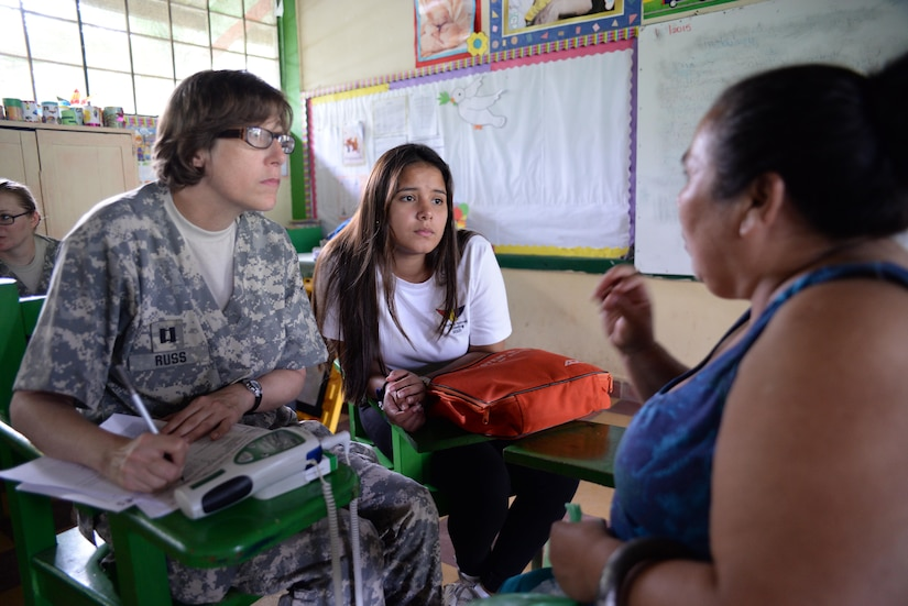 U.S. Army Capt. Michelle Russ, Joint Task Force-Bravo nurse, listens to a woman explain her symptoms during a Medical Readiness Training Exercise in San Jose de Rio Pinto, Honduras, Nov. 12, 2015. These exercises provide military members with essential training in austere locations and build local community relations within the Honduras and other nations in Central America. (U.S. Air Force Photo by Senior Airman Westin Warburton/Released)