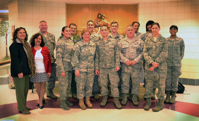 Members of the 111th Attack Wing at Horsham Air Guard Station, Pennsylvania, and volunteers with the Horsham Air Guard Station Airman & Family Readiness Center, stand for a group photo after participating in a character education program with students from Mary, Mother of the Redeemer Catholic School in North Wales, Pennsylvania, Nov. 12, 2015. 111th Attack Wing members and associated Wing civilian volunteers partnered with the school in an event intended help students develop into moral, civic and good-mannered community members. (U.S. Air National Guard photo by Tech. Sgt. Andria Allmond/Released)