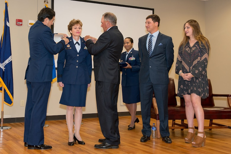 U.S. Air Force Col. Theresa Prince is pinned her star, by retired Brig. Gen. Jim Chow and her husband Ken, at McEntire Joint National Guard Base, Eastover, S.C., Nov. 7, 2015.  Prince has 37 years of military experience, 19 in the South Carolina Air National Guard and is the first female to be promoted as a general officer in the unit.   (U.S. Air National Guard photo by Tech. Sgt. Jorge Intriago/Released)