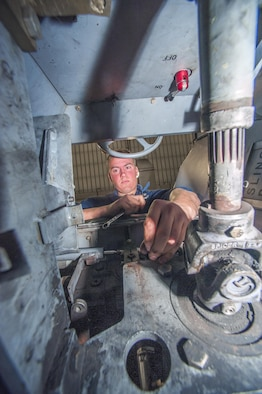 Senior Airman Nicholas Appenzeller, 8th Maintenance Squadron aerospace ground equipment journeyman, performs maintenance on a bomb lift at Kunsan Air Base, Republic of Korea, Nov. 10, 2015. The AGE flight maintains more than 600 pieces of equipment across the base valued at $15 million. (U.S. Air Force photo by Staff Sgt. Nick Wilson/Released)