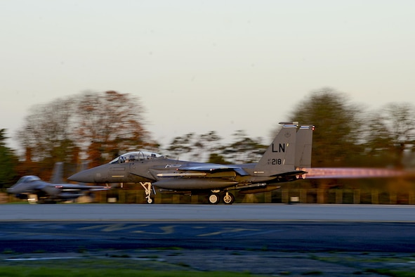 An F-15E Strike Eagle departs Royal Air Force Lakenheath, England, to support Operation Inherent Resolve Nov. 12, 2015. Aircraft from the 48th Fighter Wing deployed to Incirlik Air Base, Turkey, to conduct counter-Islamic State of Iraq and the Levant missions in Iraq and Syria. The dual-role fighter jet is designed to perform air-to-air and air-to-ground missions in all weather conditions. (U.S. Air Force photo/Senior Airman Erin Trower)