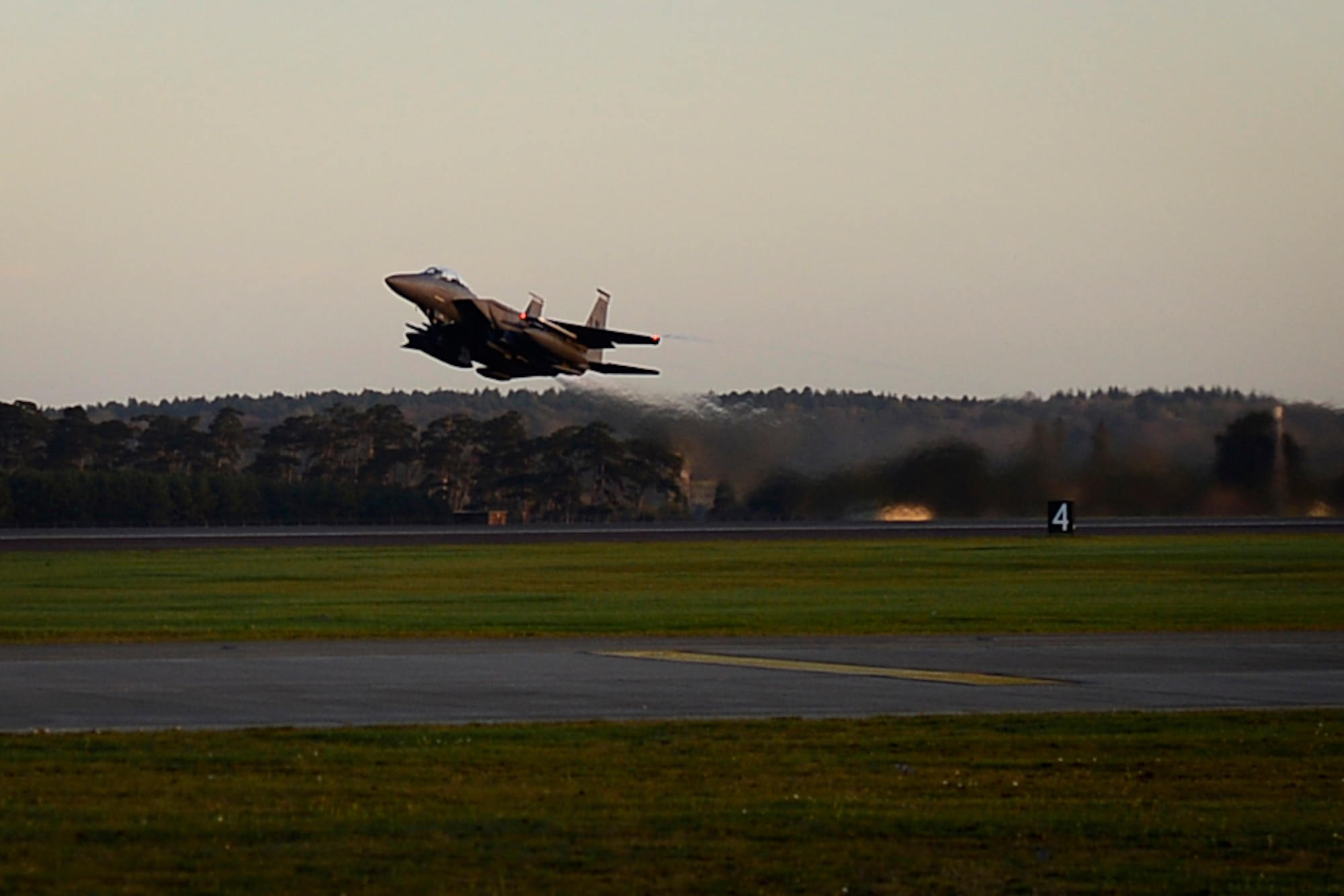 An F-15E Strike Eagle departs Royal Air Force Lakenheath, England, to support Operation Inherent Resolve Nov. 12, 2015. Aircraft from the 48th Fighter Wing deployed to Incirlik Air Base, Turkey, to conduct counter-Islamic State of Iraq and the Levant missions in Iraq and Syria. The dual-role fighter jet is designed to perform air-to-air and air-to-ground missions in all weather conditions. (U.S. Air Force photo/Airman 1st Class Erin R. Babis)