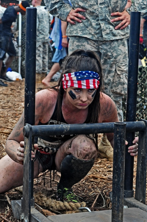 Ashley Hayes, a Tough Mudder competitor, participated in the Army Fitness Challenge after she completed the Central Florida Tough Mudder in Palm Bay, Fla., Nov. 7. For the fitness challenge, Hayes had to complete several tasks, which included pushing a weighted sleigh, three pullups, low crawling, 10 declined pushups and then pulling the weighted sleigh back to the start line.