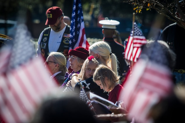 Visitors observe a moment of silence during a Veterans Day ceremony at Beaufort National Cemetery Nov. 11. The ceremony honored veterans of all wars as well as active duty service members. All branches of the military were represented.
