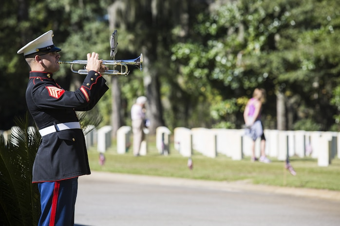A Marine plays taps during a Veterans Day ceremony at the Beaufort National Cemetery Nov. 11. The annual event is held to recognize local veterans and active duty service members. The day began with a parade through downtown and concluded with the ceremony at the cemetery. The Marine is with the Parris Island Marine Band.