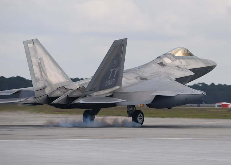 An F-22 Raptor from Tyndall Air Force Base, Fla., touches down on the flightline at Tyndall Nov. 5, 2015. The F-22's combination of stealth, supercruise, maneuverability and integrated avionics, in addition to improved supportability, represents an exponential leap in warfighting capabilities and allows for the full realization of operational concepts that are vital to the 21st century Air Force. (U.S. Air Force photo/Senior Airman Sergio A. Gamboa)