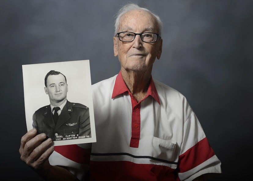 Retired Lt. Col. Clifton Ward, a World War II and Vietnam War combat pilot, shows his official photo, taken May 19, 1955, during a visit to MacDill Air Force Base, Fla., Nov. 5, 2015. During his flying career, Ward piloted 29 aircraft, was reported missing in action, and earned the Distinguished Flying Cross, the Bronze Star and the Air Medal for his actions in WWII and Vietnam. (U.S. Air Force photo/Tech. Sgt. Brandon Shapiro)