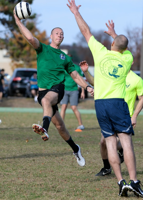 Capt. Kyle Larson, the Special Programs Division program manager, attempts a shot over a defender during a Gatorball tournament on Hanscom Air Force Base, Mass., Nov. 6, 2015. The tournament included nine teams in a double elimination format. Special Programs Division beat the Contracting Directorate by a score of 1-0 to win the tournament. Gatorball combines elements of soccer and rugby (U.S. Air Force photo/Mark Herlihy)
