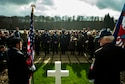U.S. and European veterans pay tribute at the grave of U.S. Army Gen. George Patton after a wreath-laying ceremony at the Luxembourg American Cemetery and Memorial in Hamm, Luxembourg, Nov. 11, 2015. Helen Patton, chairman of the Patton Foundation and Patton's granddaughter, led the tribute to her grandfather and presented medals to the veterans who served with him. (U.S. Air Force photo/Airman 1st Class Timothy Kim)