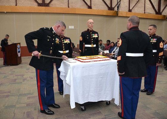 Marine Corps Maj. Chris Story cuts the first slice of cake Nov. 10. 2015 during Defense Logistics Agency Aviation's ceremony celebrating the 240th birthday of the U.S. Marine Corps in the Frank B. Lotts Conference Center on Defense Supply Center Richmond, Virginia.