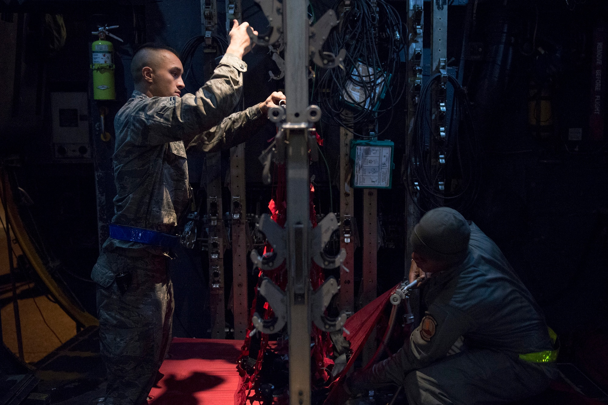 Airmen prepare seating in a C-130 Hercules during Vigilant Ace 16 at Yokota Air Base, Japan, Nov. 2, 2015. Multiple C-130s were inspected, reconfigured and fueled in preparation of flights for Vigilant Ace, a U.S. and South Korea combined exercise aimed at enhancing operational and tactical level coordination through combined and joint combat training. The exercise also provided critical training for the Airmen of the 374th Airlift Wing to maintain peace and stability in Japan and the entire Indo-Asia Pacific region. (U.S. Air Force photo/Staff Sgt. Cody H. Ramirez)
