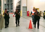Security personnel search for an active shooter in a DLA Distribution Guam, Marianas, warehouse during an exercise on Oct. 27.