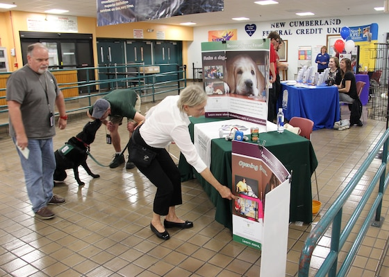 Employees of Defense Distribution Center, Susquehanna, browse the CFC Agency Fair on Nov. 5, which included service dogs, a food bank, family shelter, and crisis helpline.