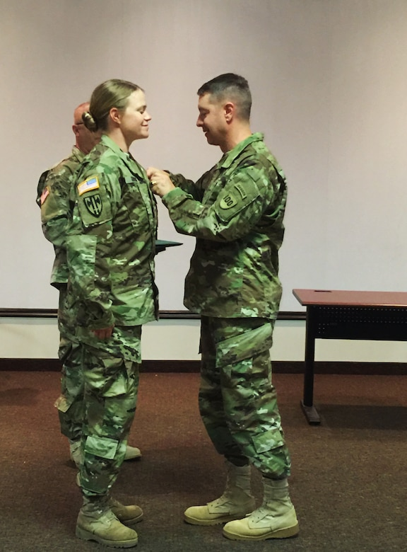 Brig. Gen. Jason Walrath, commander 100th Training Division, awards the Meritorious Service Medal to Staff Sgt. Katie Gonovi, a health care specialist instructor 100th TD, Fort Knox, Ky., Sept. 28, 2015. Govoni used her combat medic skills to help two stabbing victims in Louisville, Ky., Aug. 23, 2015.