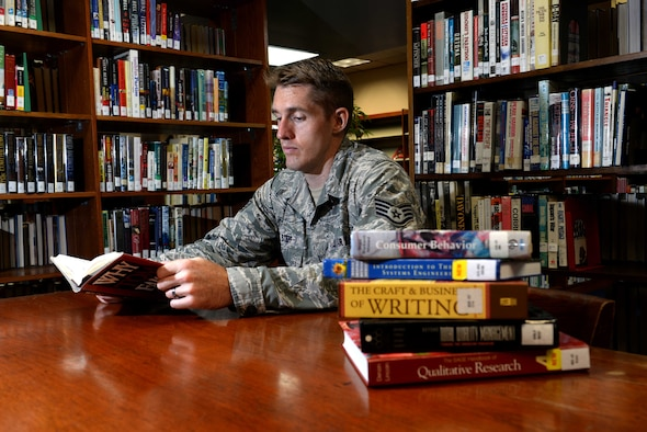 Staff Sgt. Joshua Stepp, 36th Maintenance Group quality assurance evaluator, studies at the base library Nov. 6, 2015, at Andersen Air Force Base, Guam. In fiscal 2015, more than 170 Airmen here graduated with either their associate's, bachelor's or master's degree, making Andersen AFB No. 1 for education in the Pacific Air Forces region. (U.S. Air Force photo by Airman 1st Class Alexa Ann Henderson/Released)