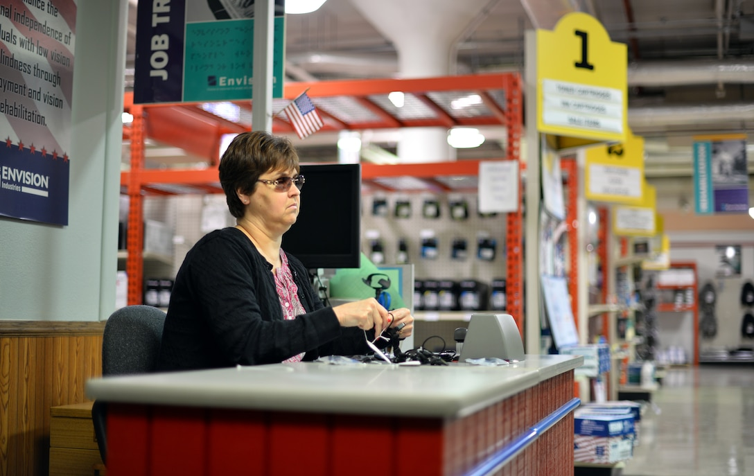 Deb Iwanksi tags merchandise Nov. 9, 2015 at the Envision Xpress store, Offutt Air Force Base, Neb. Iwasnki has been working for the store for eight months. (U.S Air Force photo by Josh Plueger)